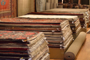 stock-photo-shopping-decor-wool-market-stacked-rugs-silk-37e2dfd7-14c0-47ec-970b-e15b7f7f997d